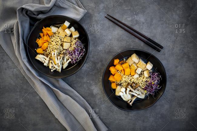 Miso Ramen soup with noodles- hokaido pumpkin- red radish sprouts- fried tofu- shimeji mushroom and king trumpet mushroom