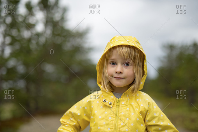 Norway- blond girl wearing rainjacket