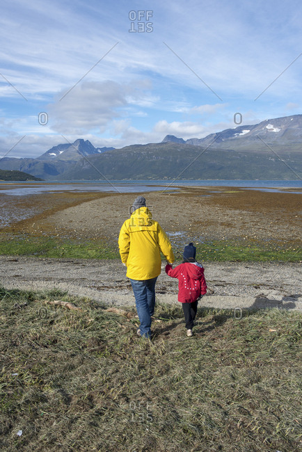 Norway- mother and daughter walking to the Lyngen fjord