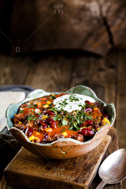 Chili con carne with kidney beans and corn- sour cream- parsley- tortilla bread