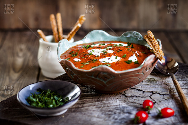 Tomato soup with sour cream and sesame sticks
