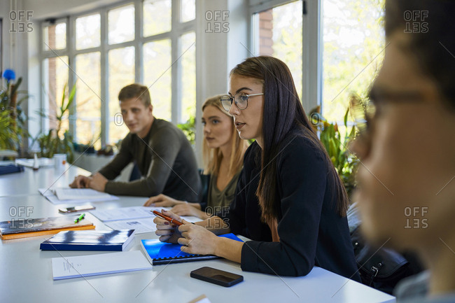 Students sitting at table at university