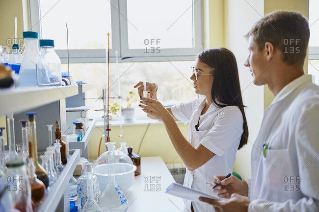 Young man and woman working together in laboratory