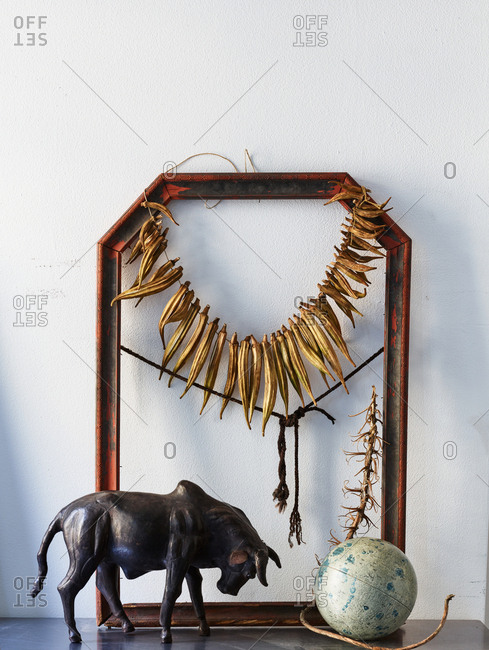 Decorations on mantle with bull and globe