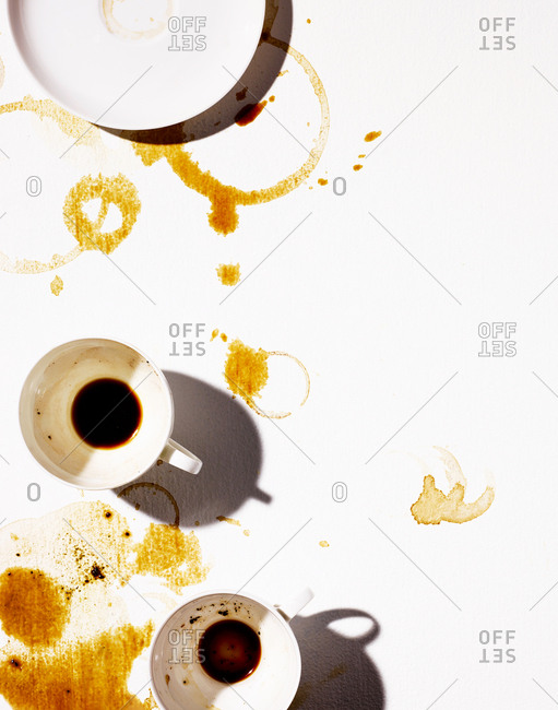 Messy coffee cups and rings on white background