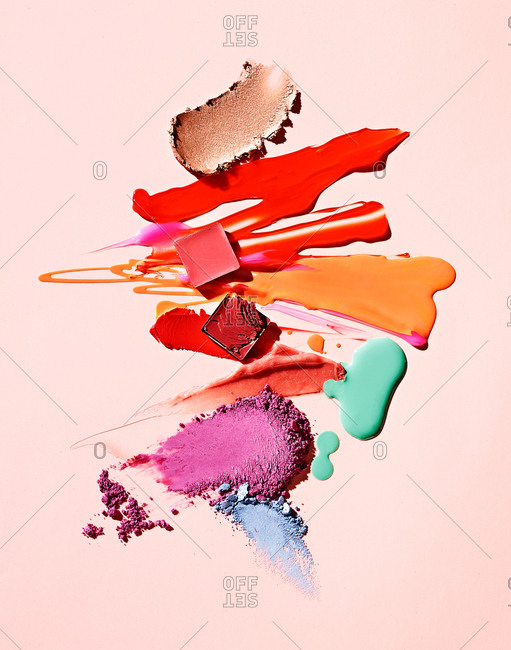 Makeup smears on pink background