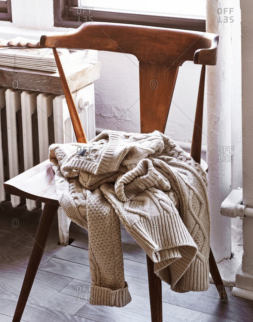 Sweater thrown on a wooden chair