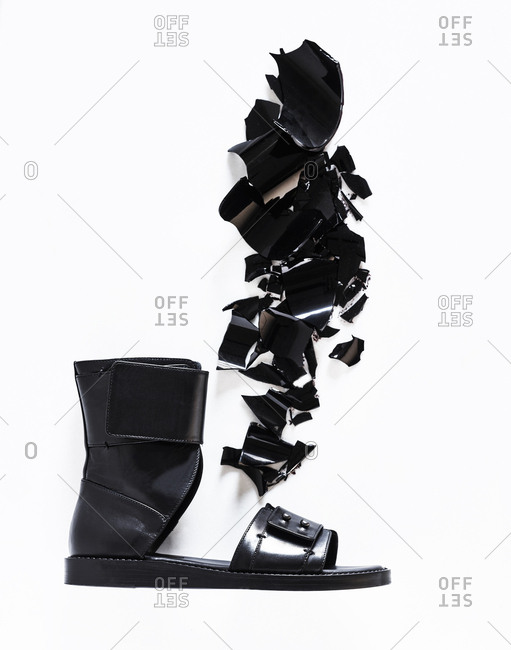 Black leather sandal on white background