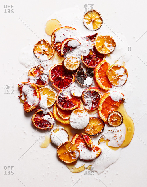Sliced and dried citrus fruit with honey and cream