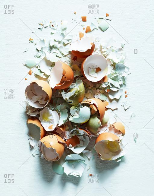 Broken eggshells on light background