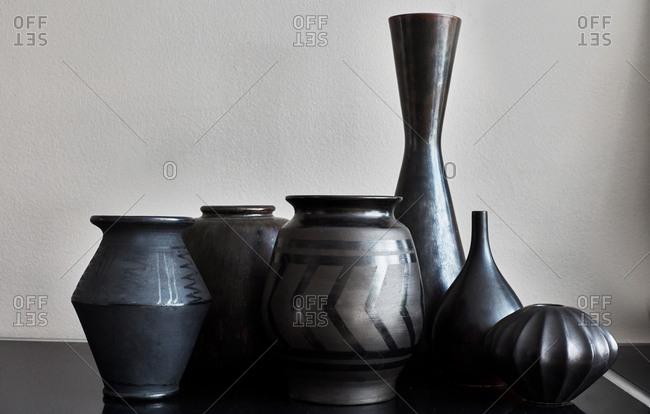 Black vases on mantle