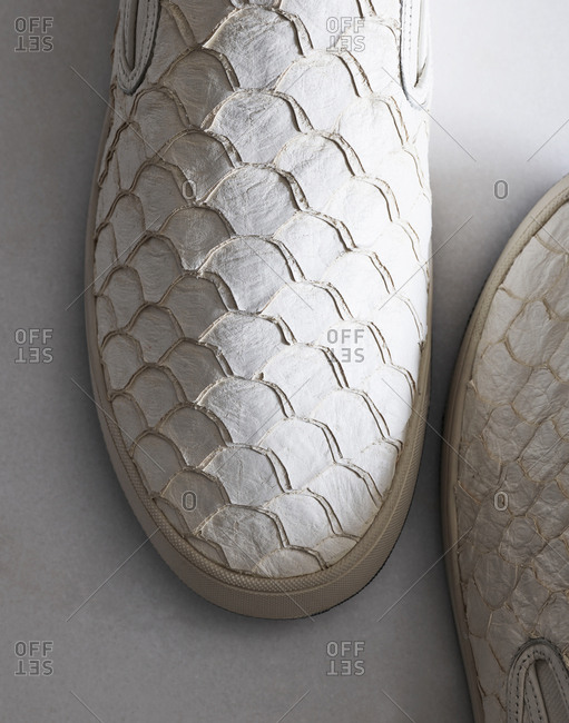 White sneakers with scallop design