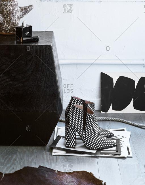 December 21, 2017 - Designer high-heeled boots and a bottle of Tom Ford Noir fragrance