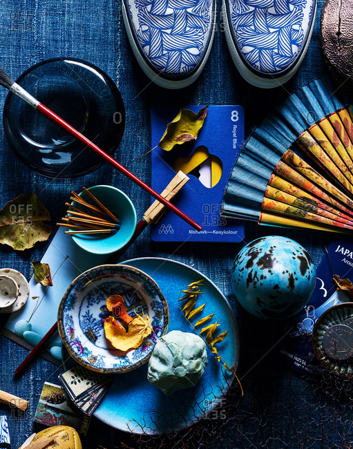 November 26, 2018 - Still life with royal blue Mohawk Keaykolour paper among a collection of Asian art objects and supplies