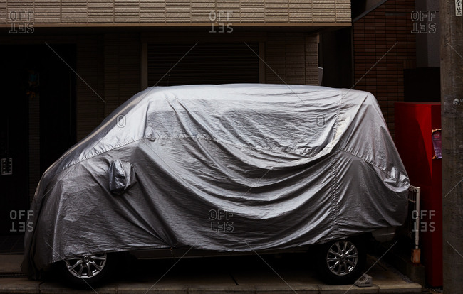 Tokyo, Japan - November 17, 2018: Covered passenger car parked outside