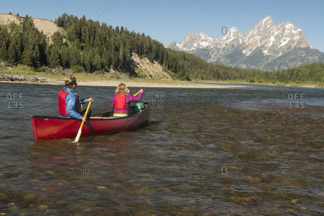 A mother and daughter canoeing the Snake River below the Grand Teton, Grand Teton National Park, Jackson, Wyoming, USA
