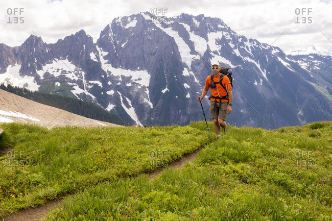 A man approaching the West Ridge of Mount Forbidden, North Cascades National Park, Marblemount, Washington State,USA
