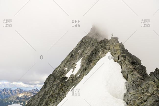 A man climbing the West Ridge of Mount Forbidden, North Cascades National Park, Marblemount, Washington State, USA