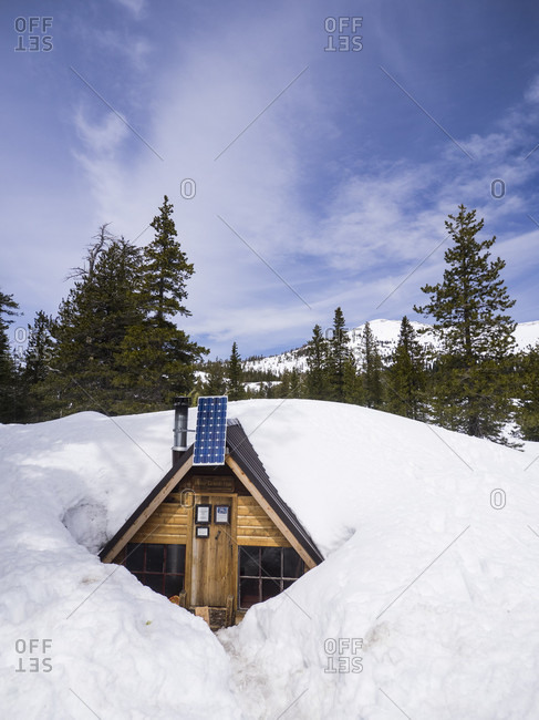View of exterior of hut buried in snow, Sierra Nevada mountains, California, USA