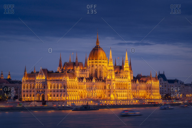 View of the exterior of Hungarian Parliament Building and Danube River at night, Budapest, Hungary