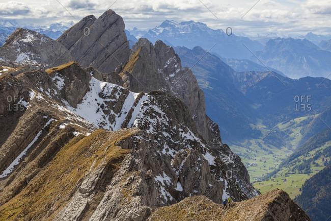 Hikers ascend to a high point off the Lisengrat (Lisen Ridge) trail between Altmann and Santis, Alpstein, canton of St. Gallen, Switzerland.