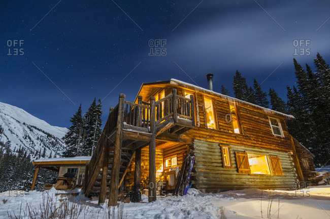 View of illuminated exterior of mountain hut at night, San Isabel National Forest, Colorado, USA