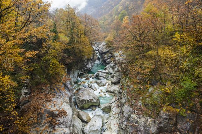 Scenic landscape with view of Verzasca River in autumn from Ponte di Corippo bridge, Ticino Canton, Switzerland