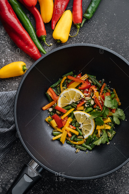 Overhead view of vegetables in a wok