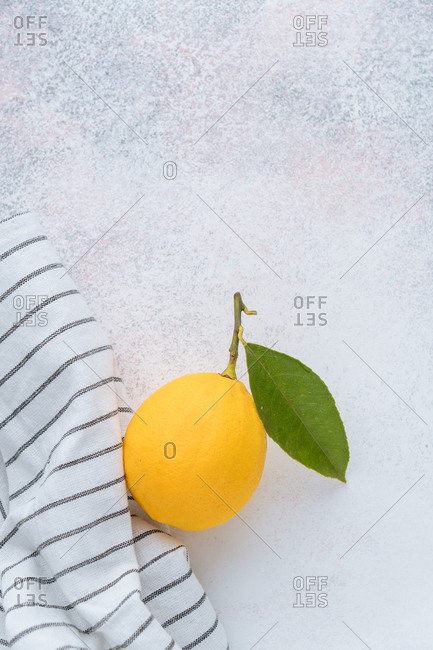 Lemon on table with striped cloth