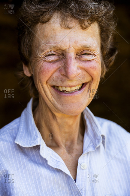 Portrait of smiling senior woman, looking at camera.