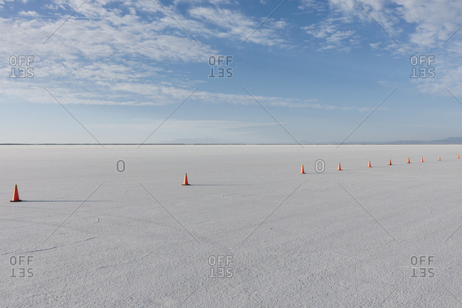 Traffic cones marking race course on Salt Flats at dusk