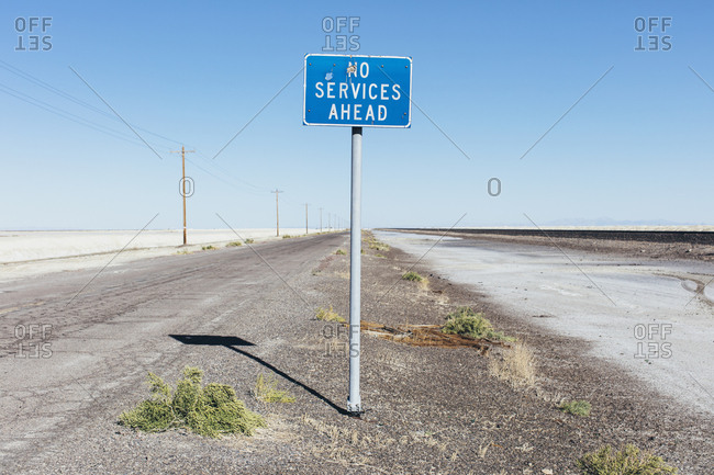 No Services Ahead sign along remote desert road
