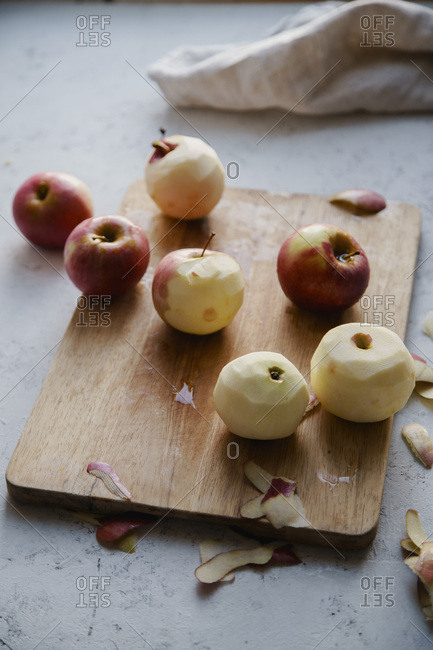 Peeling red apples for cooking an apple pie