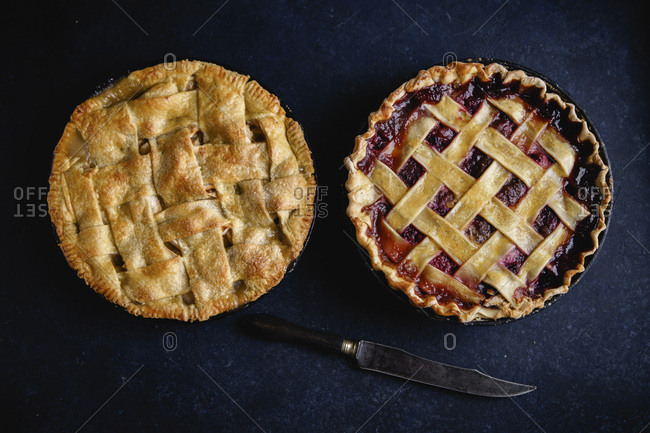 Apple pie and pie with berries on dark background