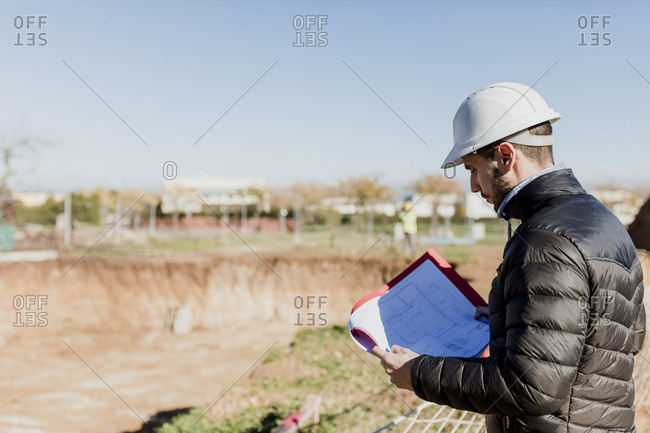 Architect reviewing plans at a worksite