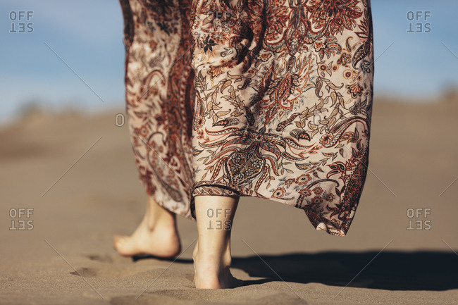 Close-up of woman's feet walking in the desert