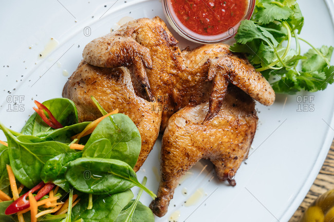 Close up of roasted chicken and salad
