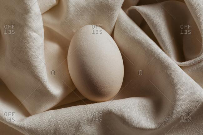 White egg on white linen