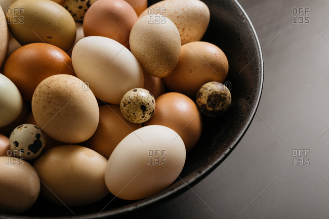 Close up of a variety of eggs in a bowl