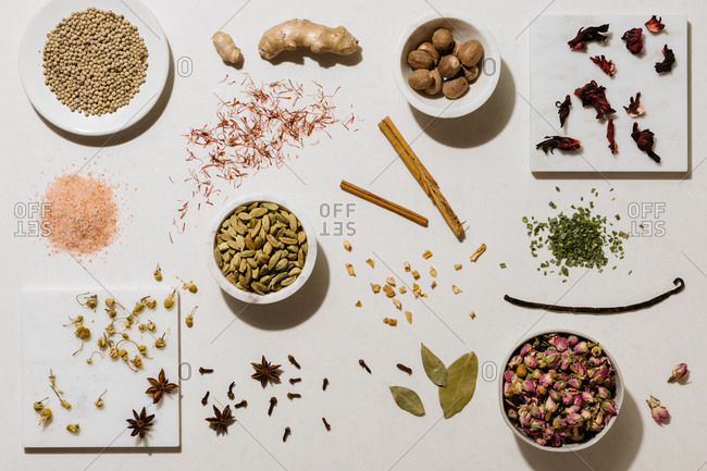 Various spices and ingredients on light background