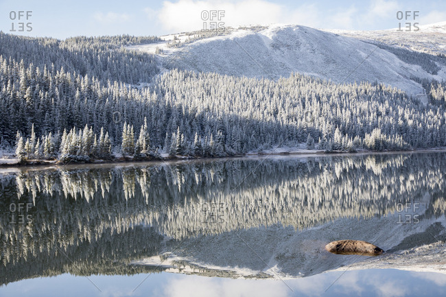 Beautiful snowy mountain reflecting in lake