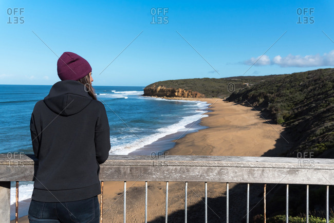 Brunette woman gazing the views at Bells Beach. Victoria, Australia.