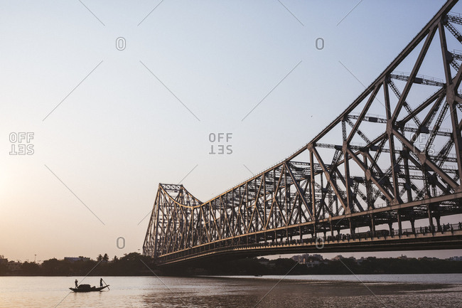 Kolkata, India - April 3, 2018: A boat near Howrah Bridge, which spans the Hooghly River in Kolkata