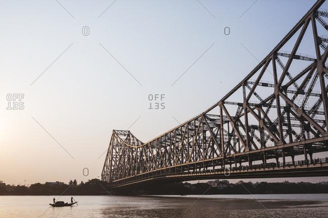 Kolkata, India - April 3, 2018: A boat near Howrah Bridge, which spans the Hooghly River in Kolkata