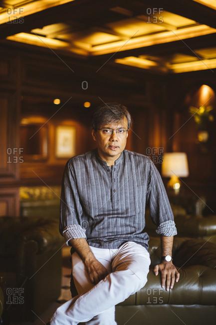 Kolkata, India - April 3, 2018: A portrait of Amit Chaudhuri, a Bengali writer and university professor, at the Taj Bengal in Kolkata