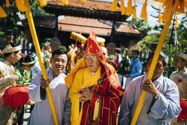 Nha Trang, Vietnam - July 28, 2018: Priest at the beginning of a wedding procession at a Buddhist temple in southern Vietnam