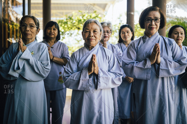 Nha Trang, Vietnam - July 28, 2018: Nuns praying at a Buddhist temple in southern Vietnam