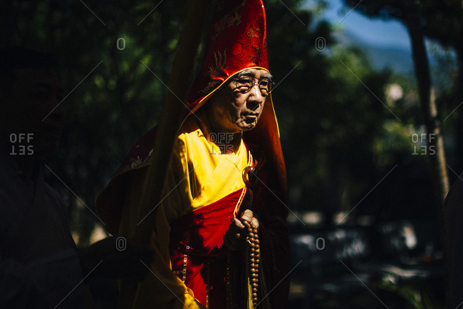 Nha Trang, Vietnam - July 28, 2018: Portrait of a priest in a wedding procession at a Buddhist temple in southern Vietnam