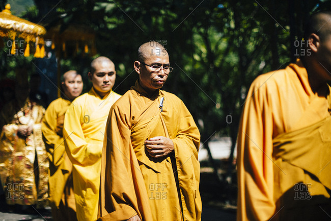 Nha Trang, Vietnam - July 28, 2018: Monks walking in a wedding procession at a Buddhist temple in southern Vietnam