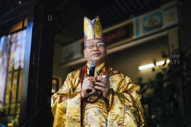 Nha Trang, Vietnam - July 28, 2018: A Buddhist priest at a wedding ceremony in southern Vietnam